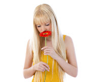 Attractive blonde woman smelling daisy Stock Photos