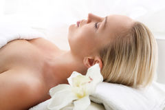 Attractive blonde woman in spa salon Royalty Free Stock Image