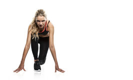 Attractive blonde woman in start position Stock Image