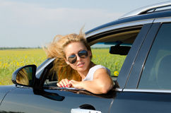 Attractive blonde woman with sunglasses Stock Photos