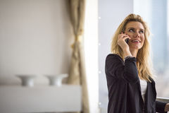 Attractive blonde woman talking on the cell phone. Work. Stock Images