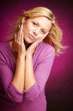 Attractive blonde woman in violet sweater Royalty Free Stock Photo