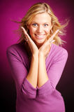 Attractive blonde woman in violet sweater Royalty Free Stock Image