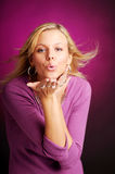 Attractive blonde woman in violet sweater Stock Images