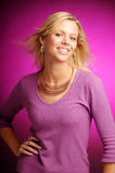 Attractive blonde woman in violet sweater Stock Photo