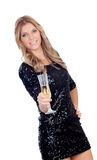 Attractive blonde woman wearing black sequins toasting with cham Stock Photo