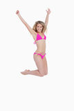 Attractive blonde woman wearing a pink swimsuit Royalty Free Stock Images