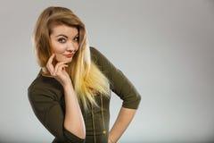 Attractive blonde woman wearing tight green khaki top Stock Photos