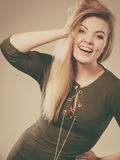 Attractive blonde woman wearing tight green khaki top Royalty Free Stock Image