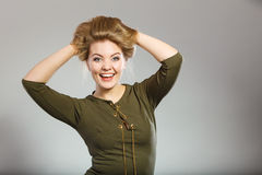 Attractive blonde woman wearing tight green khaki top Royalty Free Stock Photography
