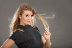 Attractive blonde woman with windblown hair Royalty Free Stock Photos