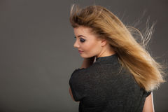 Attractive blonde woman with windblown hair Stock Photography