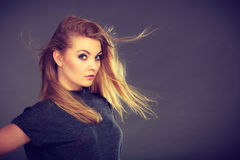 Attractive blonde woman with windblown hair Royalty Free Stock Image