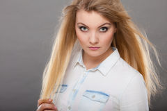 Attractive blonde woman with windblown hair Royalty Free Stock Photography