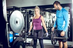 Trap bar deadlift woman with personal trainer Royalty Free Stock Photography