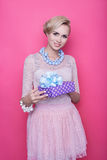 Attractive blonde women holding purple gift. Christmas. Holiday Stock Images