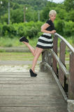 Attractive blonde on the wooden bridge Stock Photo
