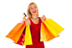 Attractive blonde young woman with shopping bags isolated.  Royalty Free Stock Photography