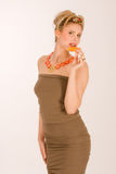 Attractive blonde young woman with strawberry-kiwi Stock Photos