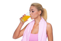 Attractive blondedrinking orange juice Stock Photography