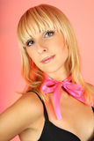 Attractive blondie girl over pink background Royalty Free Stock Images