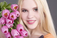 Attractive blondie girl with tulips Royalty Free Stock Photo