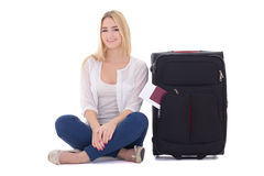 Attractive blondie woman with suitcase, passport and ticket sitt Royalty Free Stock Image