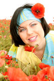 Attractive blue-eyed brunette. Is in the poppy field Stock Images