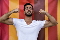 Attractive bold young man showing biceps Royalty Free Stock Photo