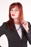 Attractive boss. An older but very attractive woman glancing at someone Stock Photo