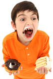 Attractive Boy Enjoying Sweets Royalty Free Stock Photo