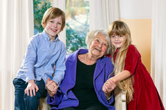 Attractive boy and girl with their grandmother. Stock Images