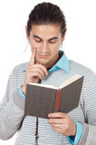 Attractive boy reading a book. Over white background Stock Images