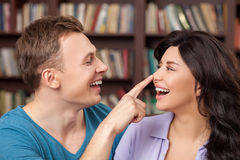 Attractive boyfriend and girlfriend are making fun Stock Photo