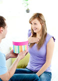 Attractive boyfriend giving present to his friend Royalty Free Stock Photo