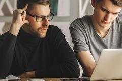 Attractive boys discussing project Royalty Free Stock Photography
