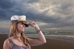 Brave girl with dimples and marine cap at the seacoast Royalty Free Stock Photo