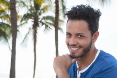 Attractive brazilian man with palms in the background Stock Photos