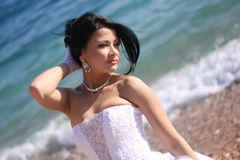 Attractive bride. Portrait of beautiful young bride on the sea coast Royalty Free Stock Photos