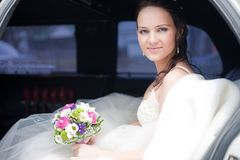 Attractive bride in a car Stock Photo