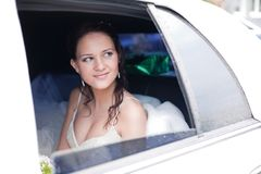 Attractive bride in a car Royalty Free Stock Image