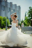 Attractive bride dancing  in long magnificent Stock Images