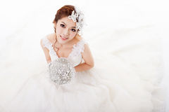 Attractive bride with flowers Stock Photo