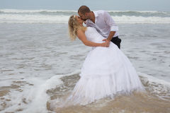 An attractive bride and groom getting married Stock Photos
