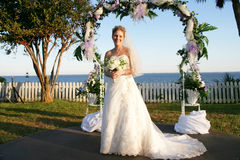 Attractive bride outside. Beautiful Caucasian bride on wedding day Royalty Free Stock Image