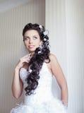 Attractive bride posing indoor Royalty Free Stock Images