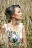 Attractive bride sitting in grass. Attractive bride sitting  in the grass Royalty Free Stock Image
