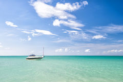 Attractive bright view of exotic colorful beautiful marine beach with boat on blue water Royalty Free Stock Photos