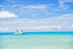 Attractive bright view of exotic colorful beautiful marine beach with boat on blue water Stock Image