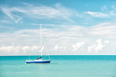 Attractive bright view of exotic colorful beautiful marine beach with boat on blue water Royalty Free Stock Image